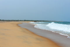 Empty sandy beach washed by the ocean Royalty Free Stock Photo