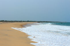 Empty sandy beach washed by the ocean Stock Image