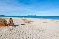 Empty sandy Mediterranean beach. In spring sunshine in Majorca, Spain Stock Images