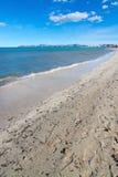 Empty sandy Mediterranean beach. In spring sunshine in Majorca, Spain Stock Image