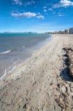 Empty sandy Mediterranean beach. In spring sunshine in Majorca, Spain Royalty Free Stock Photography