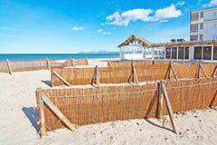 Empty sandy Mediterranean beach. In spring sunshine in Majorca, Spain Royalty Free Stock Photo