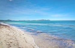 Empty sandy Mediterranean beach. In spring sunshine in Majorca, Spain Stock Photo