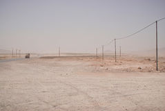 Empty sandy road in Central Iran Stock Photography