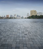 An empty scene of a stone tile floor and Bangkok city Royalty Free Stock Photos