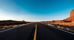 Empty scenic highway in Monument Valley. Arizona, USA Royalty Free Stock Photography