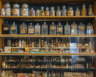 Empty scent bottles in old pharmacy. Background stock images