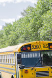 Empty school bus on suburban street with trees Stock Image