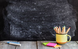 Empty school chalkboard and wooden table stock photos