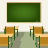 Empty school classroom with blackboard and desks Royalty Free Stock Photography