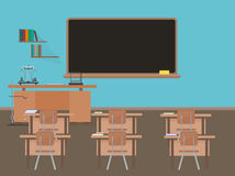 Empty school classroom with blackdesk, pupils student tables and chairs. Stock Photo