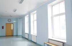Empty school corridor. School, education and learning concept - empty school corridor Royalty Free Stock Photos