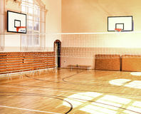 Empty School gym with basketball boards Stock Photo