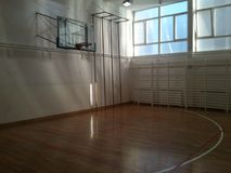 Empty school gym ready for game stock photography