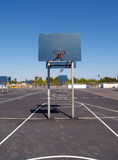 Empty school yard basketball courts parking lot Stock Photo