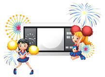 An empty scoreboard with two cheerdancers Royalty Free Stock Photography