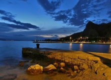 Empty sea port. Photo of beautiful empty ship port (harbor) in Omis and Adriatic sea with amazing sky in sunset (Croatia Dalmatia) at the end of the summer when royalty free stock image