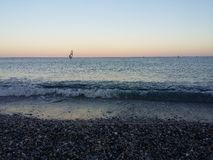 Empty Sea. There is a Wind Surf on the Left of the Image Stock Photography