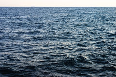 Empty Seascape. Choppy waves stretch to the horizon, where the faint silhouette of a cruise ship is visible Royalty Free Stock Photos