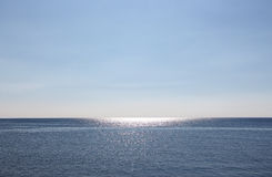 Empty seascape, with reflections over the water Royalty Free Stock Photos