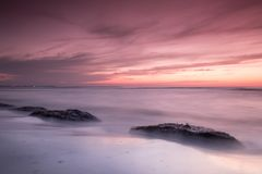 seashore with red colours at dusk stock image
