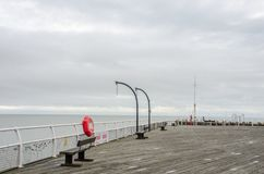 Empty seaside pier out of season Royalty Free Stock Photos