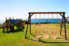 Empty seaside playground, Crete island, Greece Stock Photo