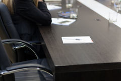 Empty seat at the conference table Stock Photo