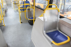 Empty seat inside a city bus Royalty Free Stock Photo
