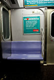 Empty seat inside a Mahattan Subway car. Royalty Free Stock Photos