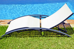 Empty seat next to the pool Stock Image