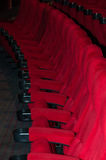 Empty seat on row in thearter perspective Stock Photos