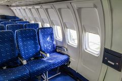 Empty seat rows in commercial aircraft cabin. Royalty Free Stock Photography