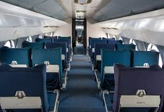 Empty seat rows in commercial old aircraft cabin. Stock Photos