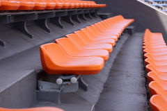 Empty seat rows in a track and field stadium Royalty Free Stock Photography