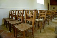 Empty wooden chairs Stock Images