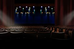 Empty vintage auditorium or theater with lights on stage royalty free stock photography