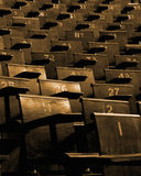 Empty seats. Strength in numbers. Seats in a lecture hall Stock Photos