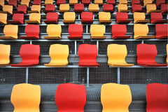 Empty seats. Many red and yellow  empty seats in a rows Royalty Free Stock Image