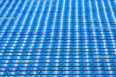 Empty Seats. Rows of empty blue stadium seats stock photo