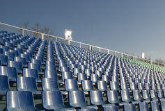Empty seats. Row of an empty seats and blue sky Stock Photos