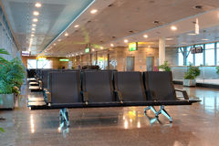 Empty seats in airport waiting area. Rows of seating in an empty airport waiting area Royalty Free Stock Photo
