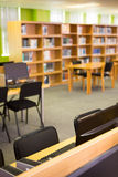 Empty seats and bookshelves Royalty Free Stock Photo