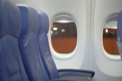 Empty seats in the cabin. Empty seats near window in the cabin airplane Royalty Free Stock Photos