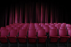 Empty seats in the cinema with old red curtain Royalty Free Stock Photo