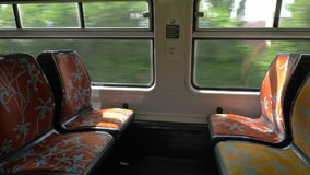 Empty seats in commuter train. Four empty seats in moving commuter train moving through the town stock video footage