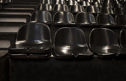Empty seats in the concert hall. Empty seats in a concert hall waiting for the audience Royalty Free Stock Photography
