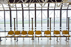 Empty seats in the departure lounge at an airport Royalty Free Stock Images