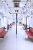 Empty seats and handrails inside commuter trains Royalty Free Stock Images