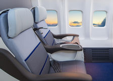 Empty seats in a modern airplane. Lonely travel by airplane to somewhere, Journey for business by airplane and see out of airplane window Royalty Free Stock Photography